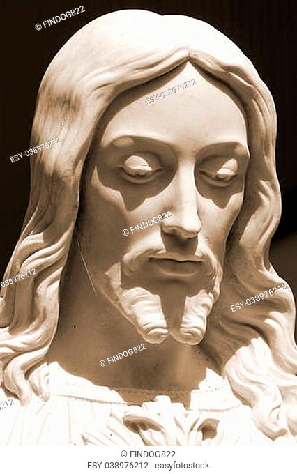 Jesus statue, close-up sepia-toned