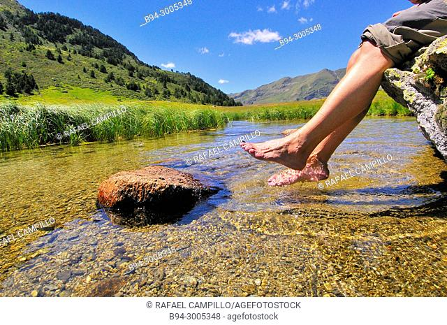 Feet in a river. Incles valley. Andorra. Europe