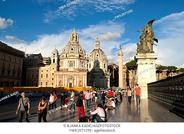 People in front of the Vittorio Emanuele II Monument with two domes of Santissimo Nome di Maria and Santa Maria di Loreto churchs and Trajan's Column behind