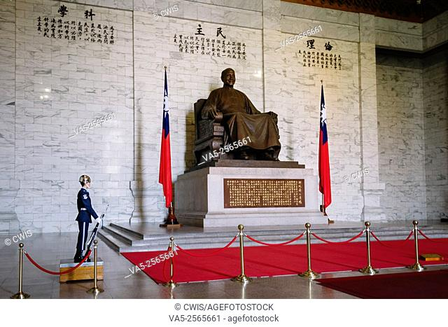 Taipei, Taiwan - The Statue of Chiang-Kai-Shek and the flag of Republic of China in the CKS Memorial Hall