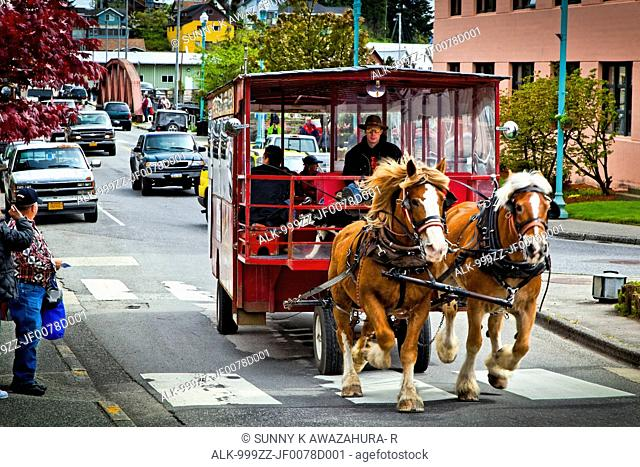 Horse-drawn wagon carries tourists from cruise ship by Creek Street, Ketchikan, Southeast Alaska, Summer