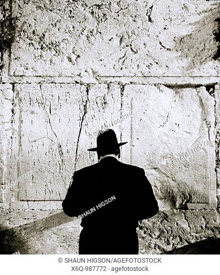 An Orthodox Jewish man conducts his prayers at the Wailing Wall, in Jerusalem, Israel