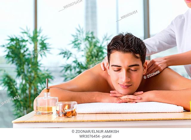 Handsome man during spa massaging session