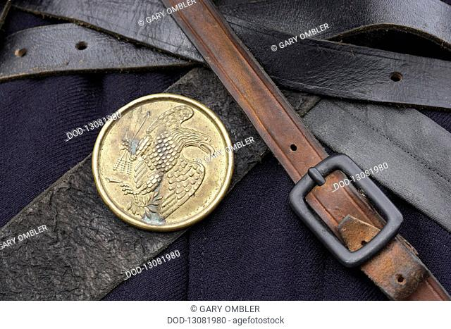 Brass eagle emblem on leather strap, as worn by Union infantrymen during American Civil War