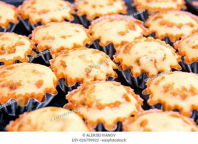 Freshly baked muffins in metal tins