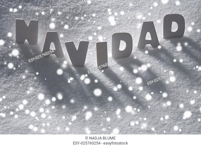 White Wooden Letters Building Spanish Text Navidad Means Christmas. Snow And Snowy Scenery With Snowfalkes. Christmas Atmosphere