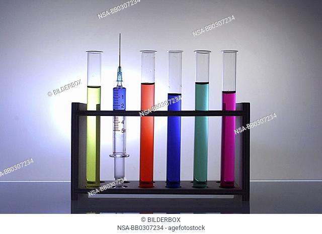 laboratory glasses with coloured liquids
