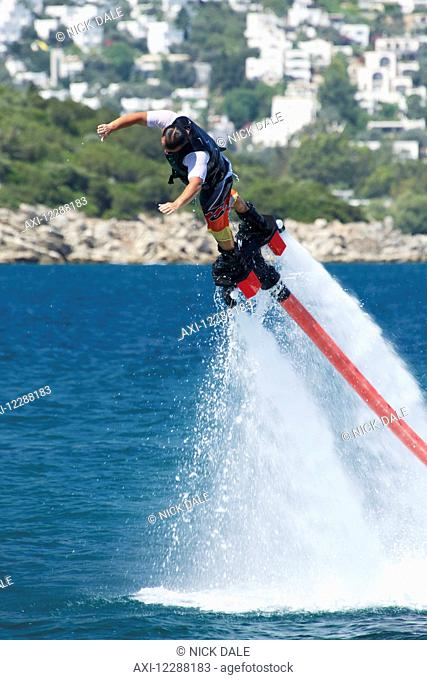 Flyboarder diving into water from great height; Torba, Mugla Province, Turkey