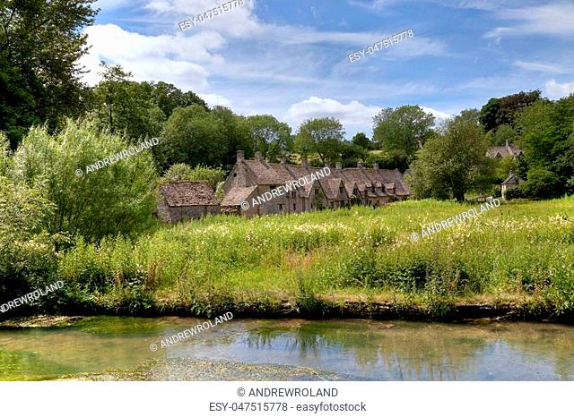 Arlington Row at the pretty Cotswold village of Bibury, Gloucestershire, England