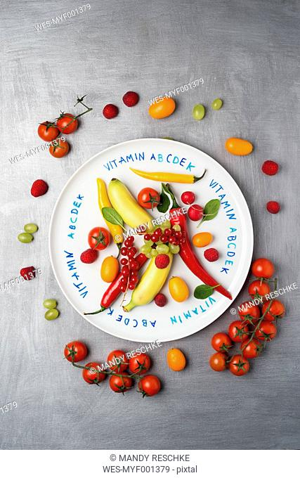 Different fruits and vegetables on plate, vitamins