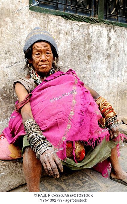old lady with many bracelets begging to survive, the nepalis , life in kathmandu , kathmandu street life , Nepal