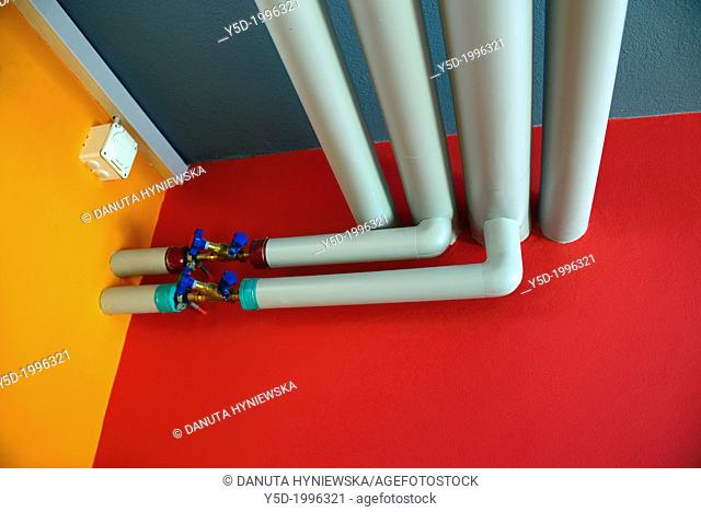 colorful detail of building infrastructure, warm and cold water pipes