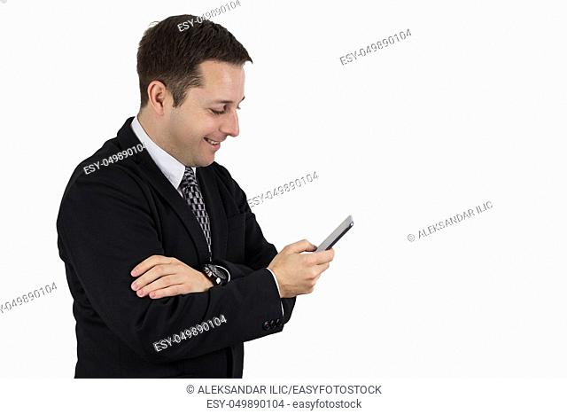 Businessman in Black Suit Holding Phone While Smiling and Feeling Happy Against White Background