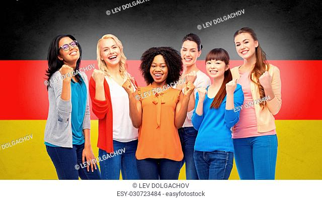 diversity, ethnicity and people concept - international group of happy smiling different women celebrating success over german flag background