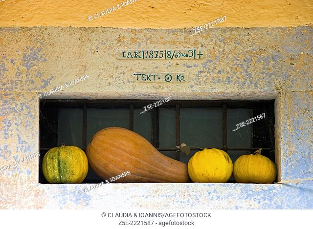 Still life with pumpkins in the front door of a farm house on Pelion Peninsula, Thessaly, Greece