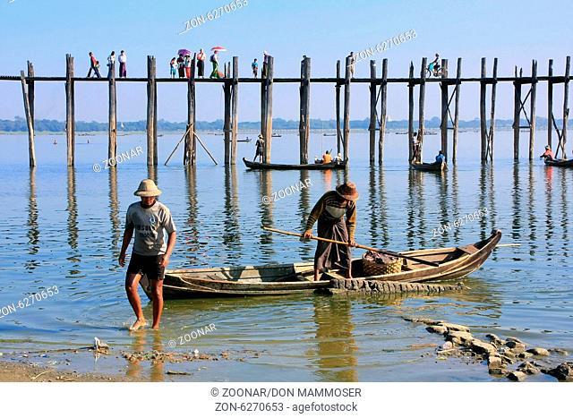 Local men in a boat near U Bein Bridge, Amarapura
