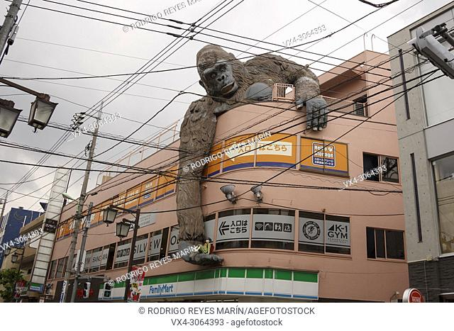 A giant gorilla holding a school girl in its hand is seen over the side of a building of Sangenjaya area on May 30, 2018, Tokyo, Japan