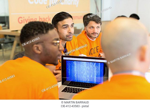 Dedicated hackers coding for charity at hackathon