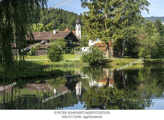 Kurpark pond and Church St. Johannes der Täufer, Grainau, Bavaria, Germany