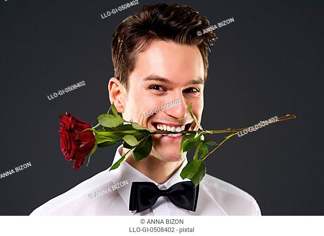 Man with a red rose in mouth, Debica, Poland