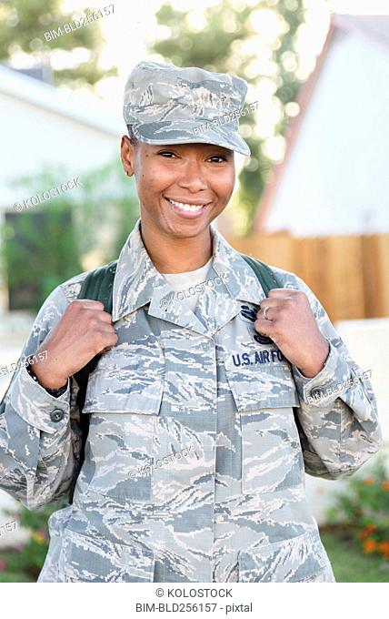 Portrait of smiling black woman soldier