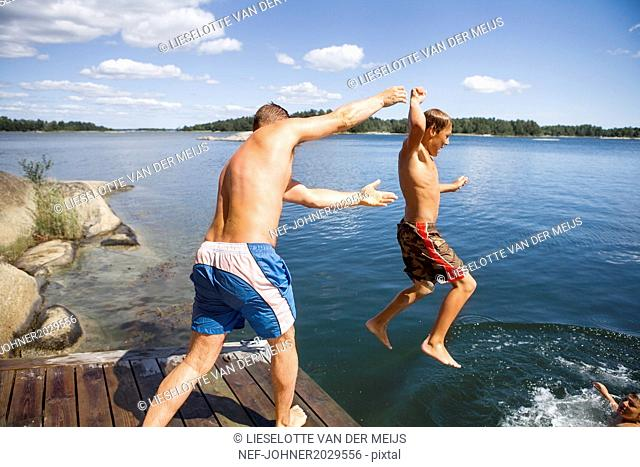 Father with son on jetty