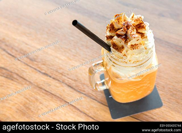 glass of Ice milk tea with Whipped Cream