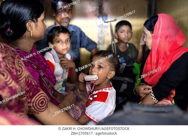 DHAKA, BANGLADESH - JUNE 30 : in Dhaka, Bangladesh on June 30, 2016. . Thousands of Bangladeshi people board an overcrowded train travelling to to their home...