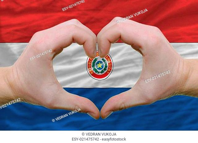 Heart and love gesture showed by hands over flag of paraguay bac