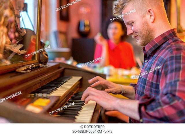 Smiling man playing organ