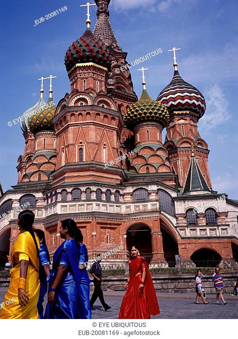 St Basil's Cathedral exterior with women in brightly coloured saris in the foreground