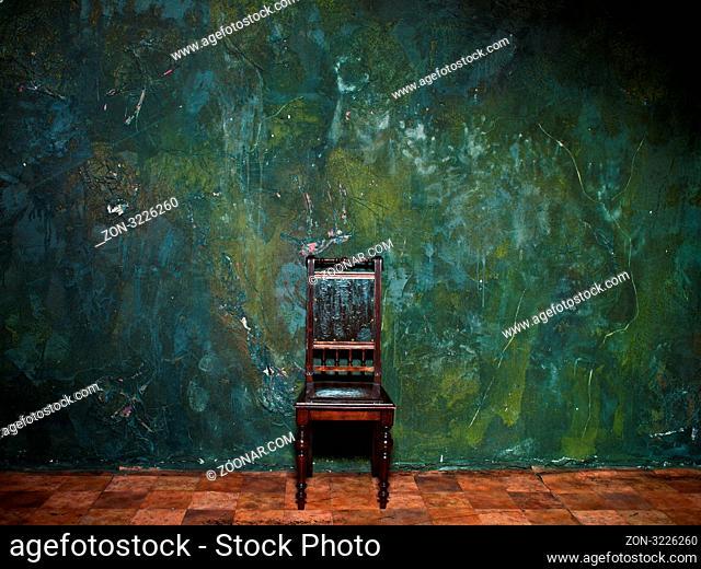 old chair in grunge interior background