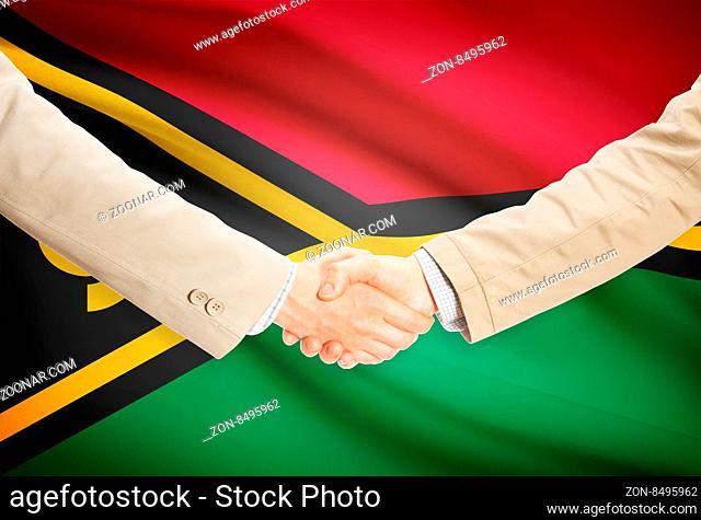 Businessmen shaking hands with flag on background - Vanuatu