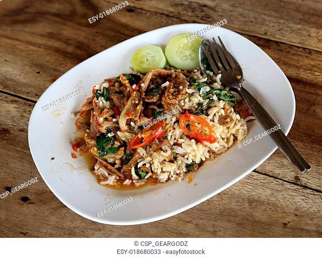 Fried pork with sweet basi and white jasmine sticky rice