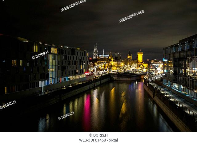 Germany, Cologne, Rheinauhafen, Christmas market at Imhoff chocolate museum by night