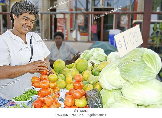 Fiji, Viti Levu, Sigatoka, fijian woman selling produce at a market