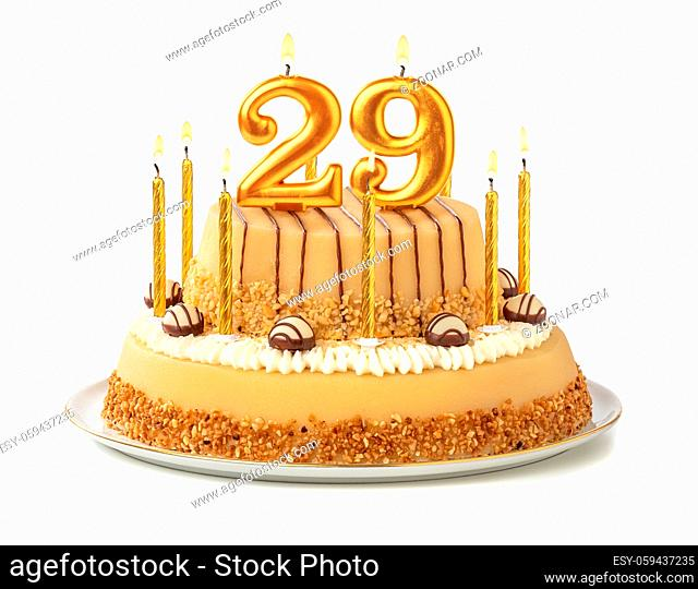 Festive cake with golden candles - Number 29