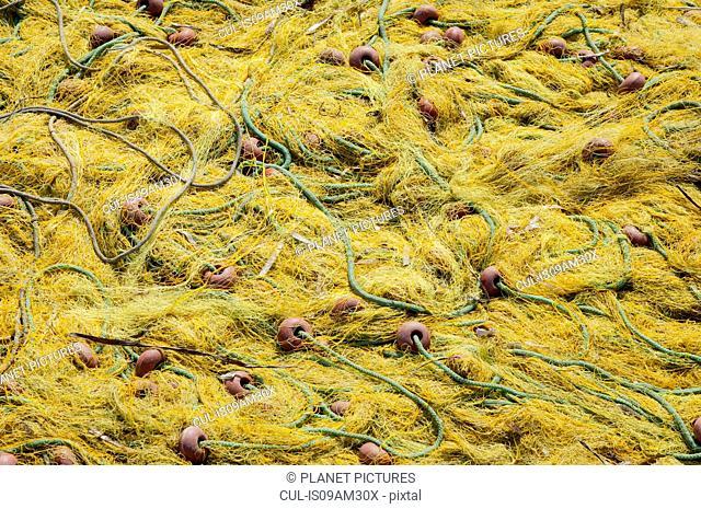 Close up of yellow fishing net drying in sunlight, Corfu, Greece