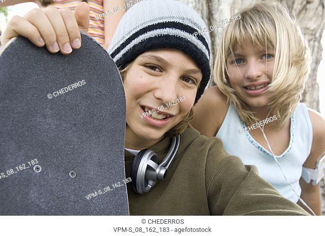 Portrait of a teenage boy and a teenage girl smiling
