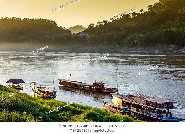 Asia. South-East Asia. Laos. Province of Luang Prabang, city of Luang Prabang, World heritage of UNESCO since 1995. Boats on Mekong river