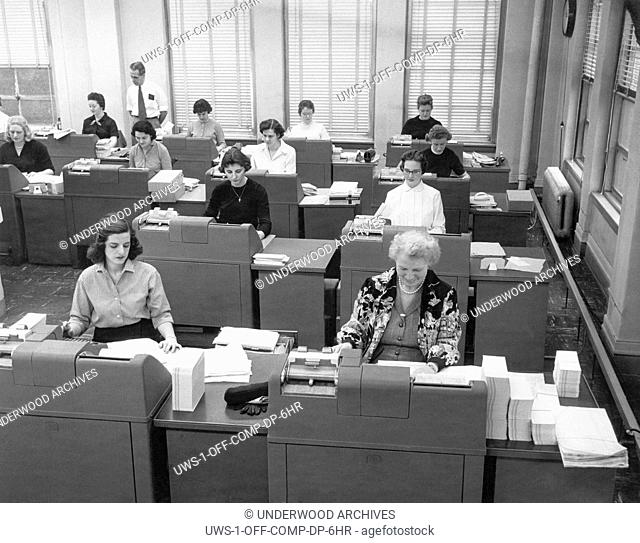 Cleveland, Ohio: January 22, 1958.Women office workers entering data using tabulating machines and punch cards at the Erie Railroad Company offices