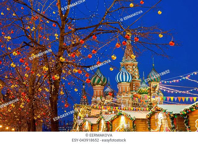 Christmas decorations at the Red Square with St. Basils Cathedral on the background, Moscow, Russia