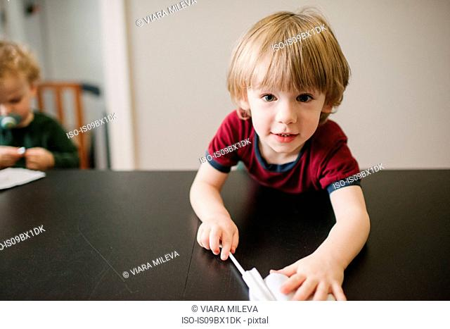 Boy playing at table