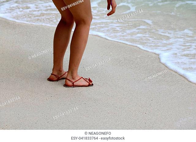 ee2c37b5bb5 Tourists girls wearing sandals or slipper enjoy the beaches and sea water
