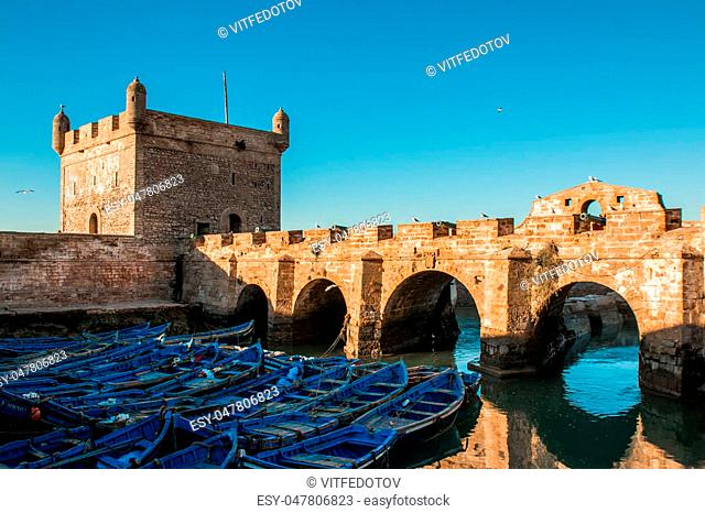 Fishing boats, gear and catch on background of Castelo Real of Mogador. Essaouira, Morocco