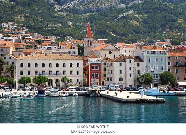 View at houses and harbour in the sunlight, Makarska, Dalmatia, Croatia, Europe