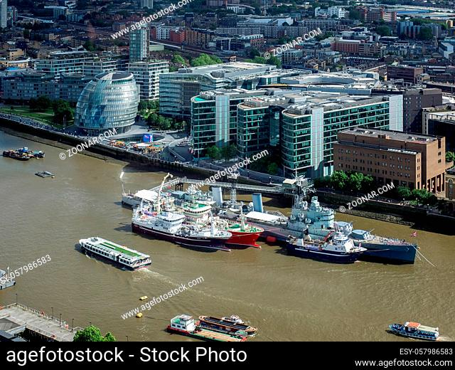 HMS Belfast and other Boats Moored in the Thames