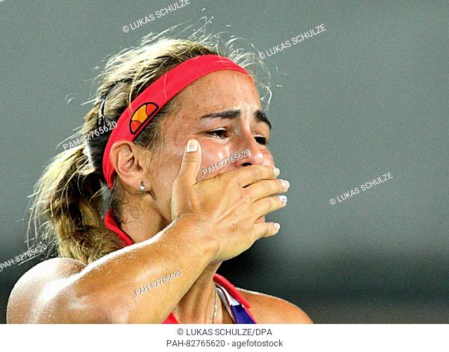 Monica Puig of Puerto Rico reacts after her match against Angelique Kerber of Germany at the Women's Tennis Singles Final during the Rio 2016 Olympic Games at...