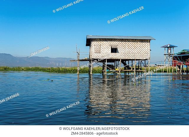 A village scene with a house on stilts in a village in Inle Lake in Myanmar