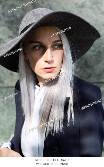 Fashionable young woman outdoors looking around